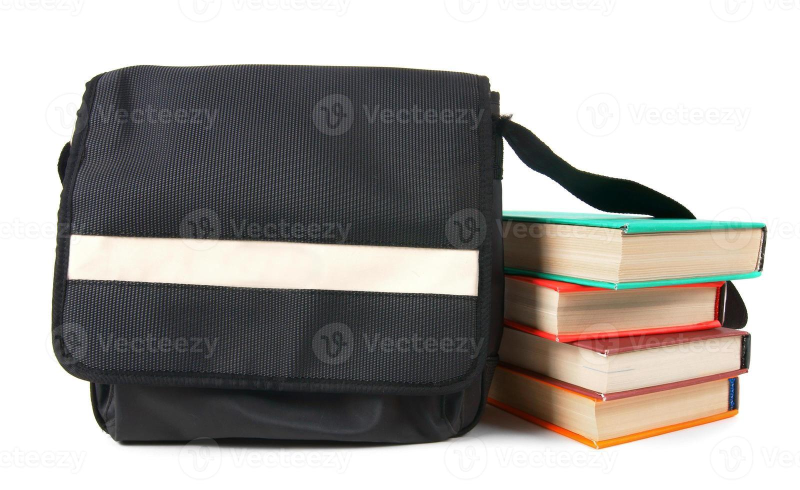 zaino e libri per la scuola. foto
