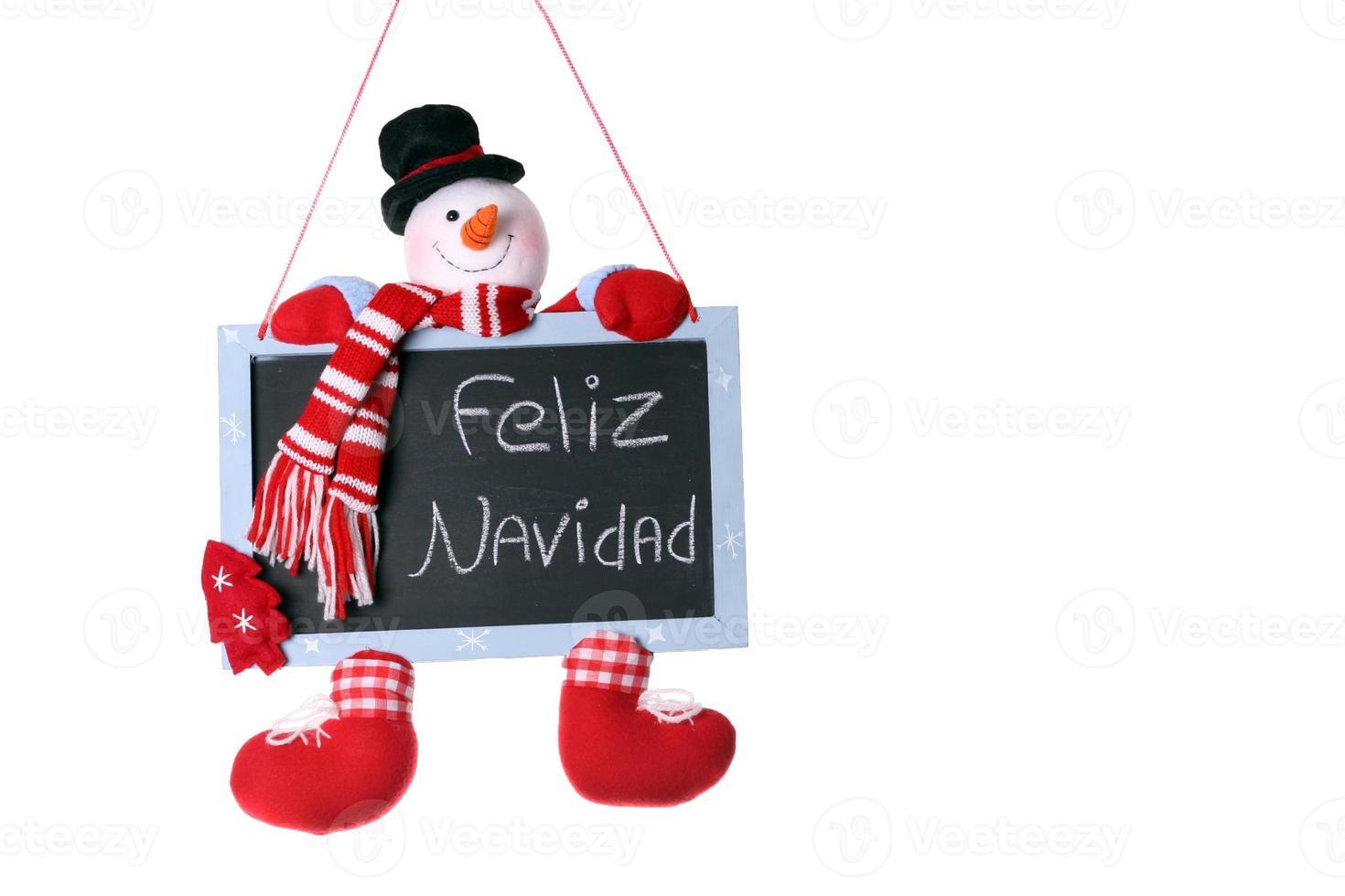 Feliz Navidad scritto sulla lavagna di Natale pupazzo di neve foto