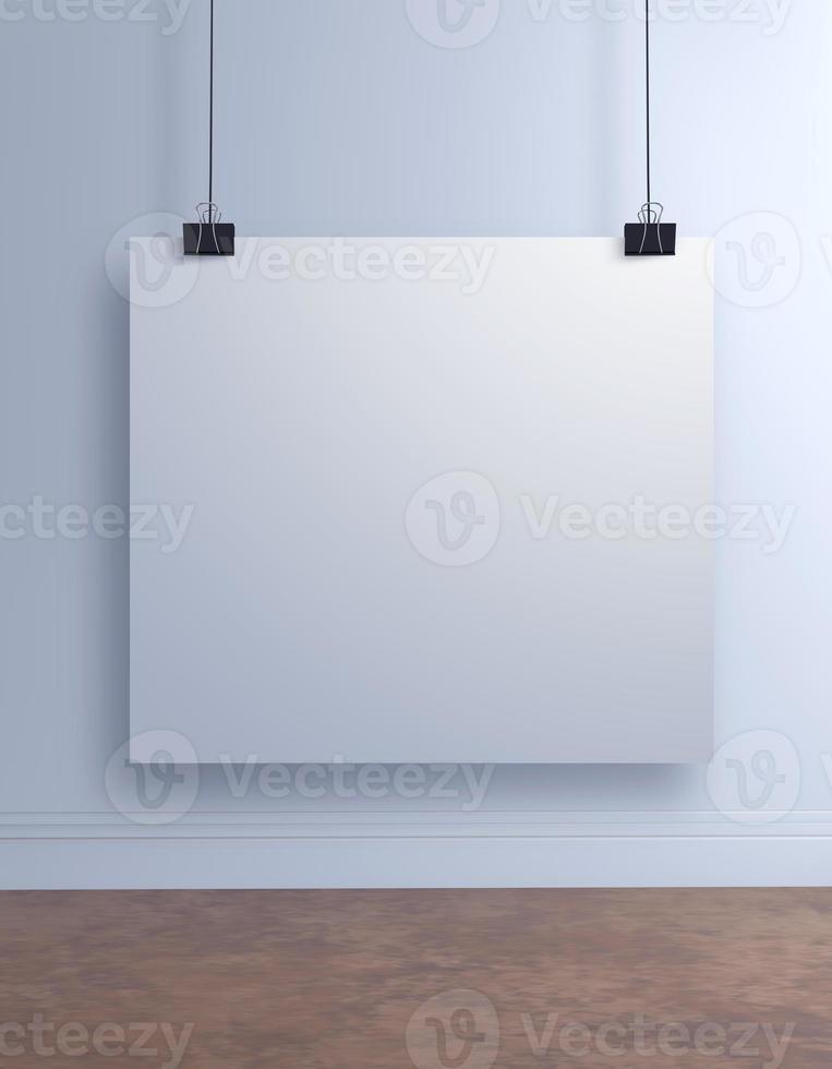 mock up poster di carta appeso al muro bianco foto