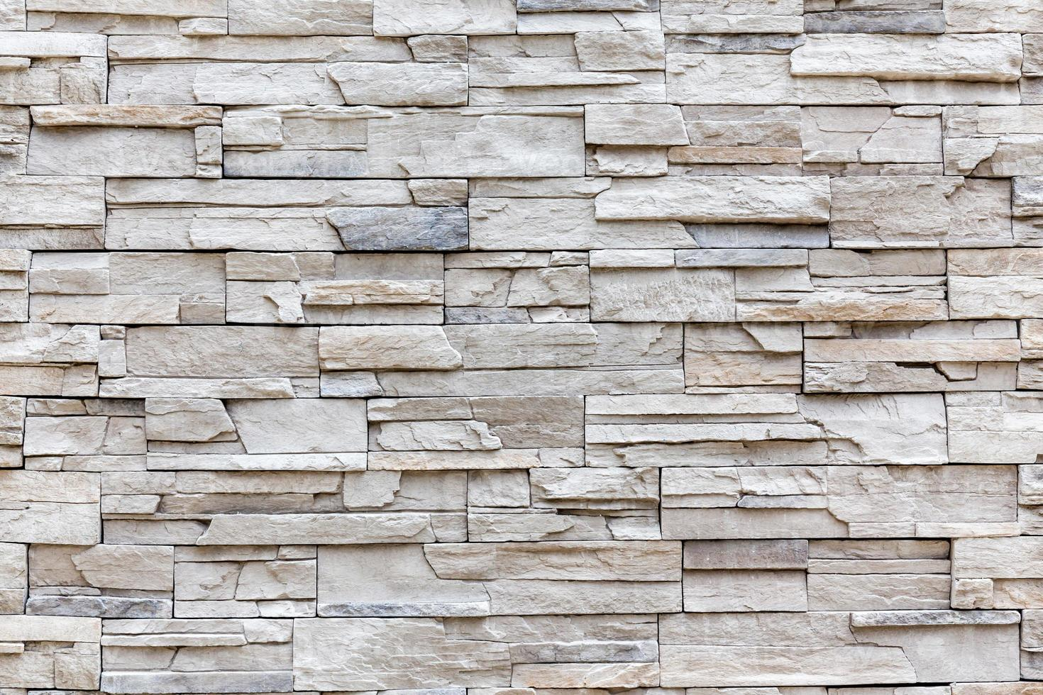 muro di mattoni esterno della roccia, modello della parete del fondo. foto