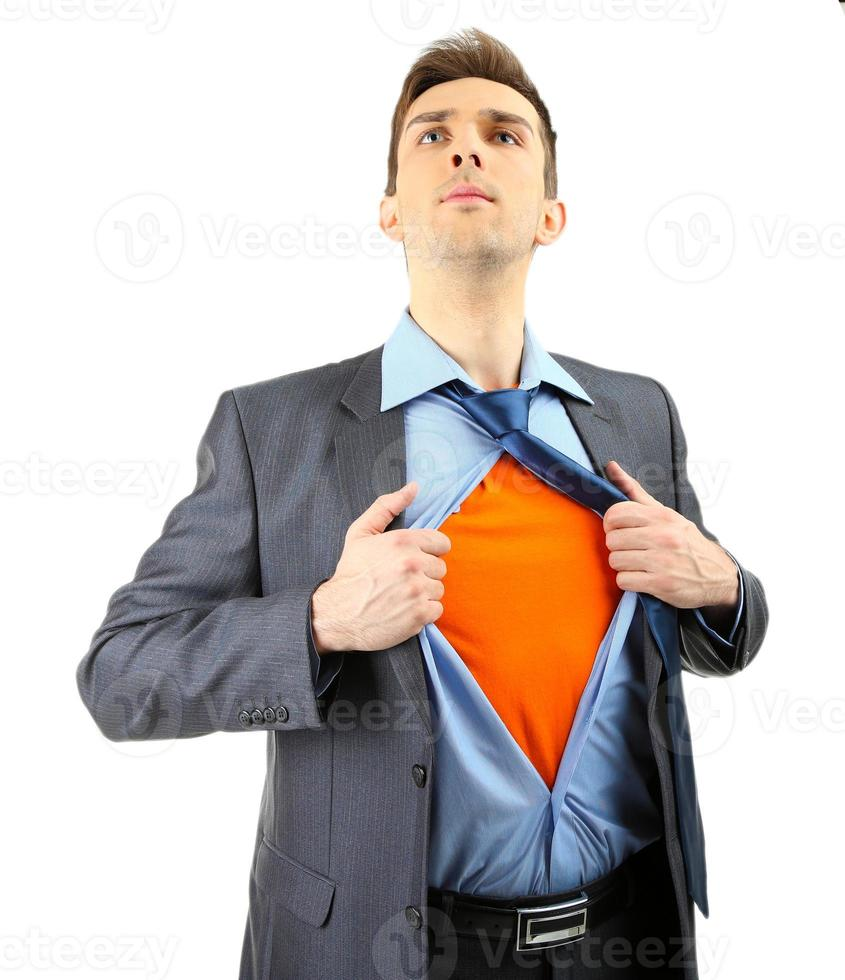 uomo d'affari strappando la camicia rivelando tuta supereroe, bianco isolato foto