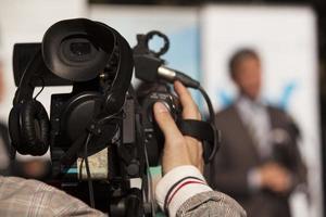 coprendo un evento con una videocamera foto