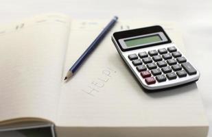 calcolatrice e nota di aiuto foto