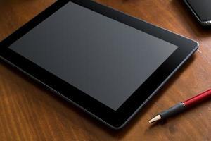 lavoro aziendale con tablet e smartphone foto