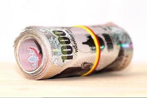 banconota da mille baht thailandesi foto