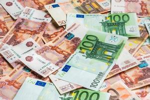 sfondo di banconote russe ed euro foto