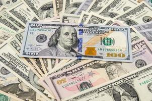 banconote di dollari come sfondo foto