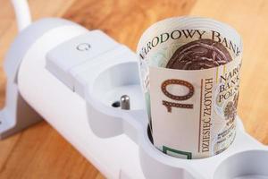 estensione di energia elettrica e denaro in valuta polacca, costi energetici foto