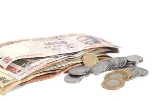 banconote e monete della rupia indiana di valuta foto