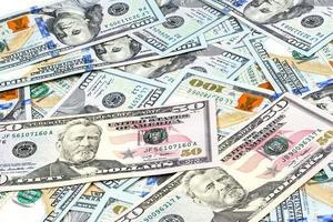 scatti ravvicinati da cento dollari di banconote foto