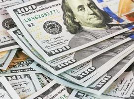 banconote da un dollaro di sfondo, da vicino foto