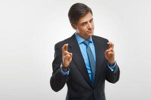 Ritratto di uomo d'affari felice su sfondo bianco foto