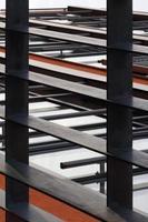 Foto del primo piano della struttura di costruzione d'acciaio in un cantiere.