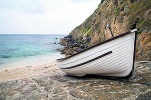 porthgawwa beach boat foto