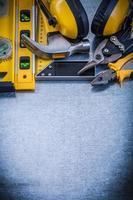 prova le pinze per martello da carpentiere a livello di costruzione quadrata foto