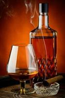 brandy e sigari foto
