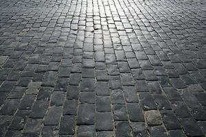 pietre che pavimentano il vecchio sfondo di trama foto