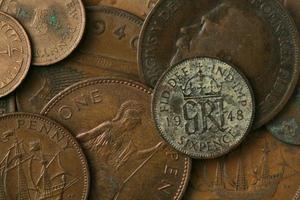 vecchia trama di monete del Regno Unito foto
