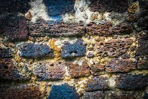 struttura del grunge del vecchio muro di pietra di laterite foto