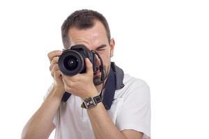 giovane fotografo isolato su bianco