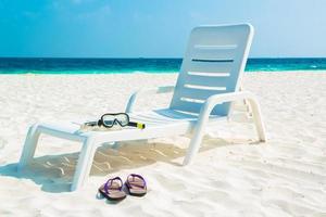 spiaggia di sabbia e onde dell'oceano, atollo di South Male. Maldive foto