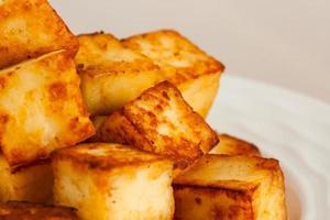 vista a macroistruzione cubi di paneer fritto indiano ghi foto