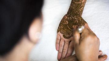 mani del hennè foto