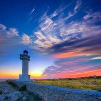 tramonto di formentera del faro del capo di Barbaria Berberia foto