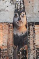 antica statua di buddha. Parco storico di Sukhothai, prov. di Sukhothai
