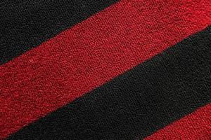 trama di tappeto rosso nero foto
