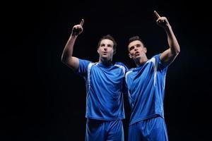 calciatori che celebrano la vittoria foto