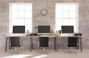 muro di cemento con interni per ufficio open space foto