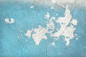 usurato muro dipinto di blu foto
