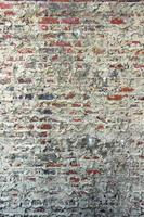 vecchio muro di mattoni e malta foto