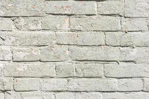 muro di mattoni bianchi. grungy muro di cemento bianco foto