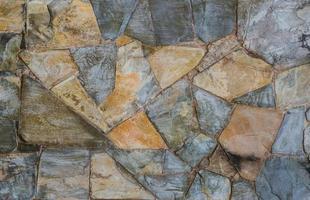 sfondo della superficie del muro di pietra ardesia foto