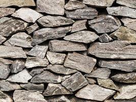primo piano del muro di pietra per lo sfondo foto