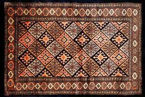 tessitura tappeto persiano foto