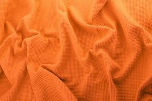 tessuto arancione come sfondo foto
