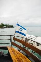 bandiera israeliana sulla barca foto