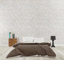 camera da letto in stile loft con muro di mattoni bianchi