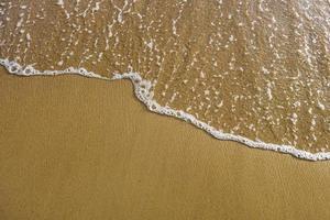 trama di onde di sabbia e mare foto