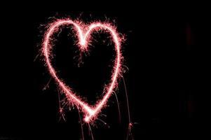 cuore di fuochi d'artificio foto