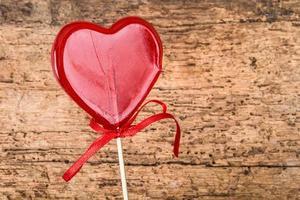 caramella rossa a forma di cuore foto