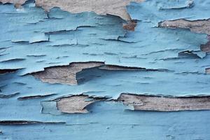 peeling dipinto sullo sfondo di legno