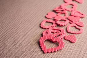 molti simboli del cuore di colore rosso foto