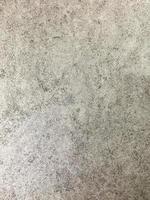 sfondo di cemento nudo grigio casuale foto
