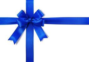 fiocco blu che copre uno sfondo bianco foto