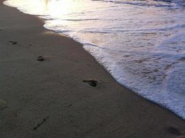 sfondo di sabbia e onde foto