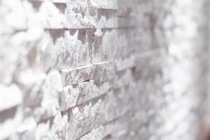 muro di mattoni bianco e nero